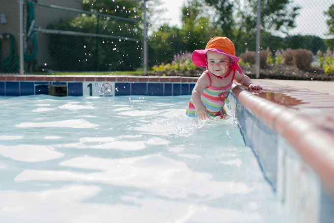 Baby in pool as tack sharp photo
