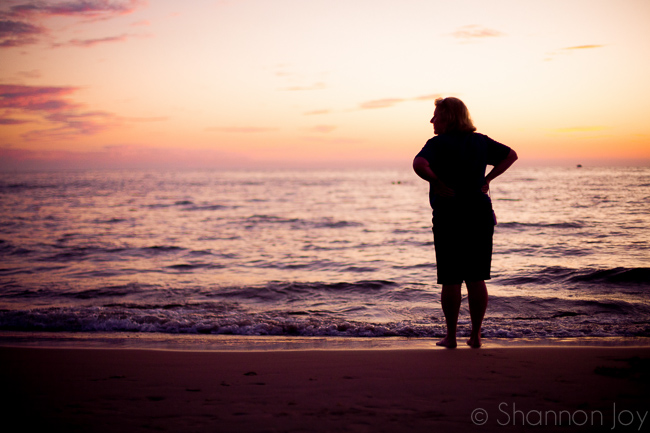 woman on a beach in sunset silhouette photography