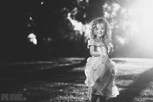 backlit-photo-of-child-dressed-like-Princess-Belle-by-April-Nienhuis