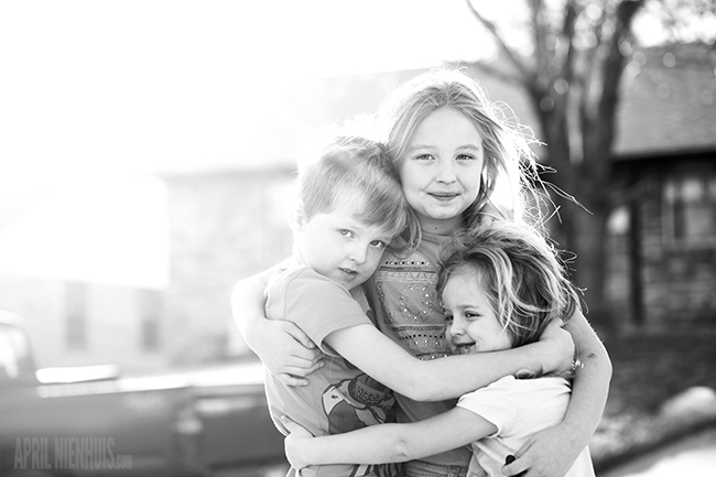 three children hugging sharp photo from f-stop