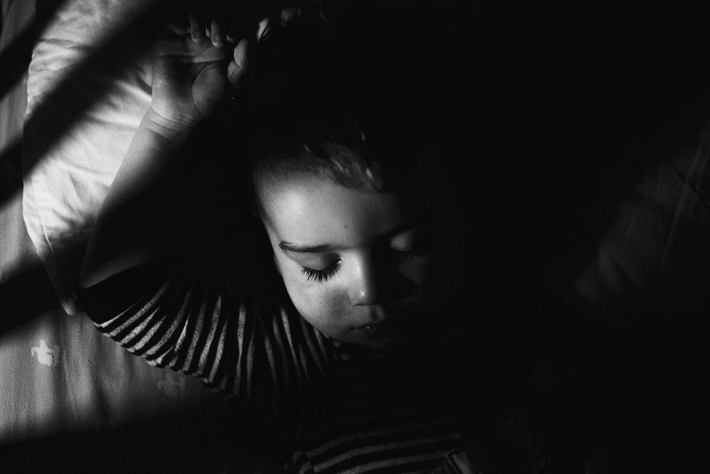 child sleeping with lights acting as leading lines