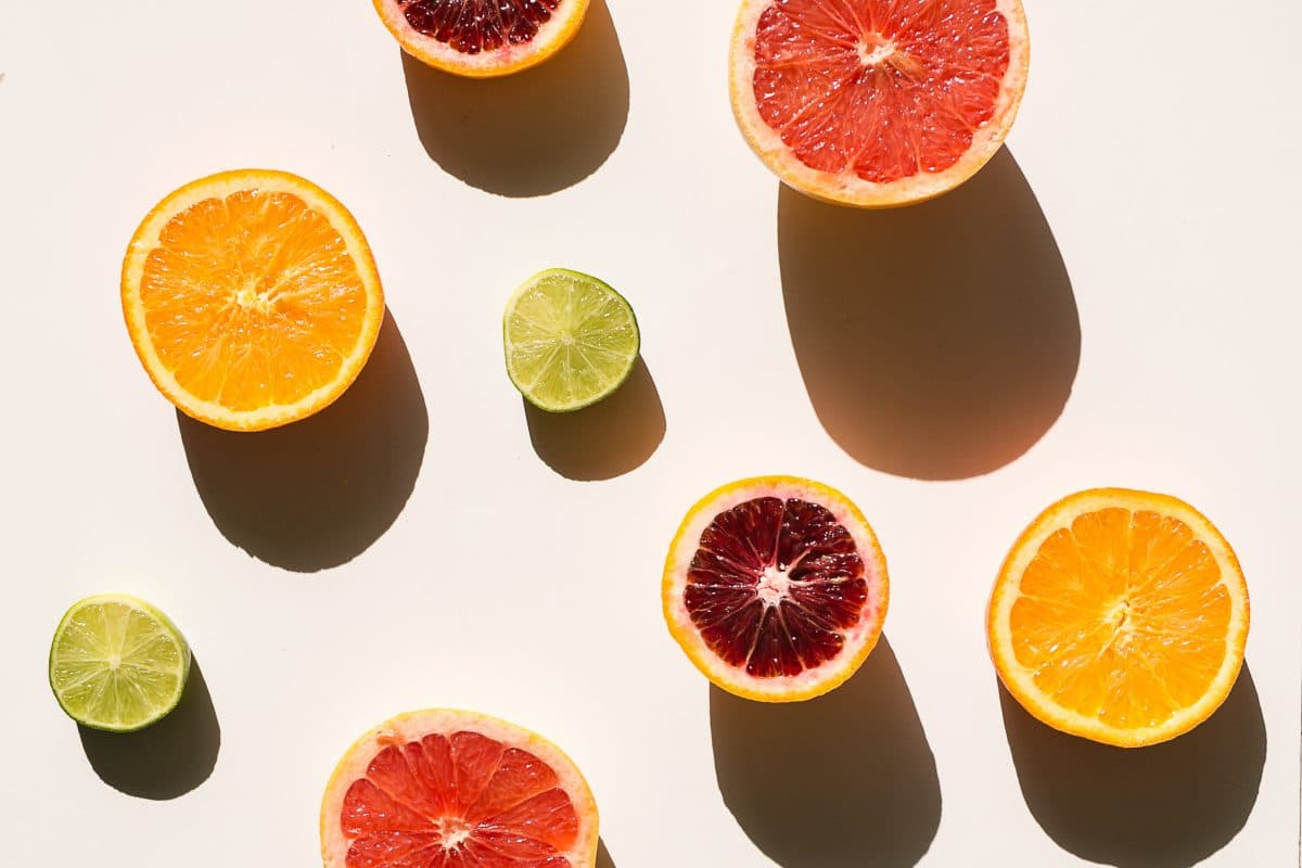 Slices of fruit all different variety and size. Example of still life photography using oranges, limes, grapefruit, and blood oranges.