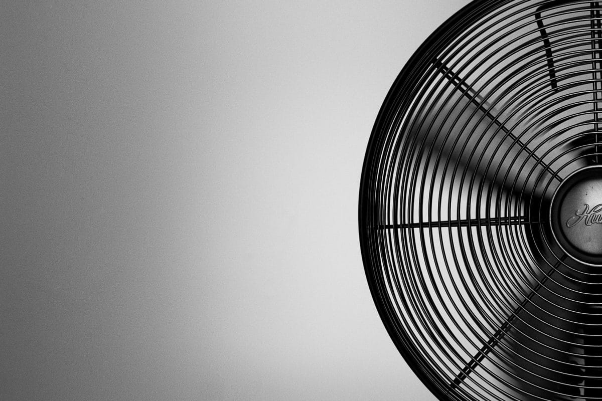 Black and white image of a fan using slow shutter speed in a still life image