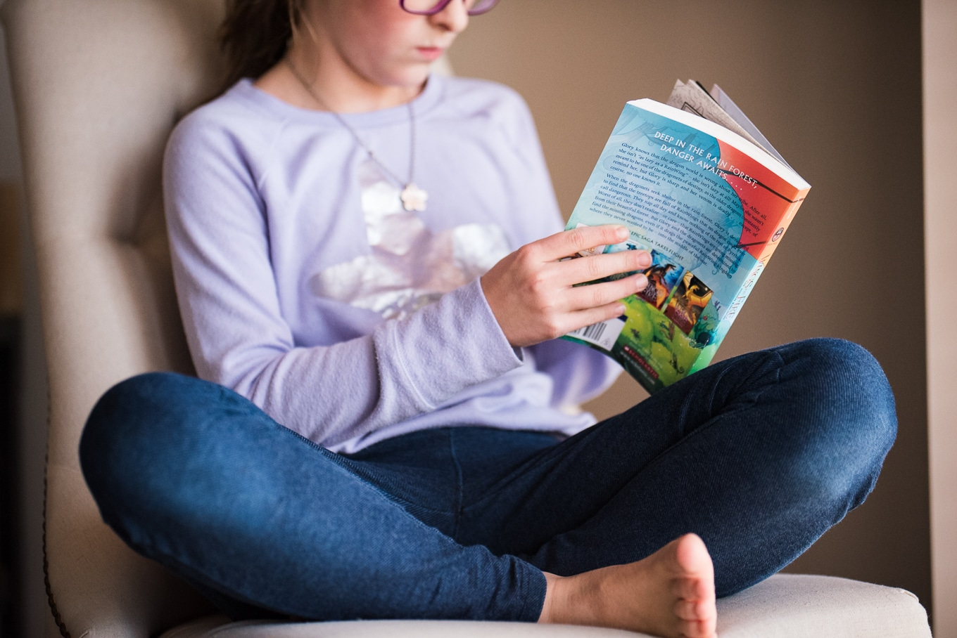 child reading wings of fire during lifestyle photography session