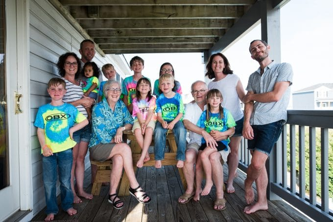 group photo of family in tie-dye shirts