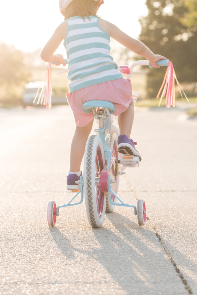 Child riding bike with airy light helps create unique photography style