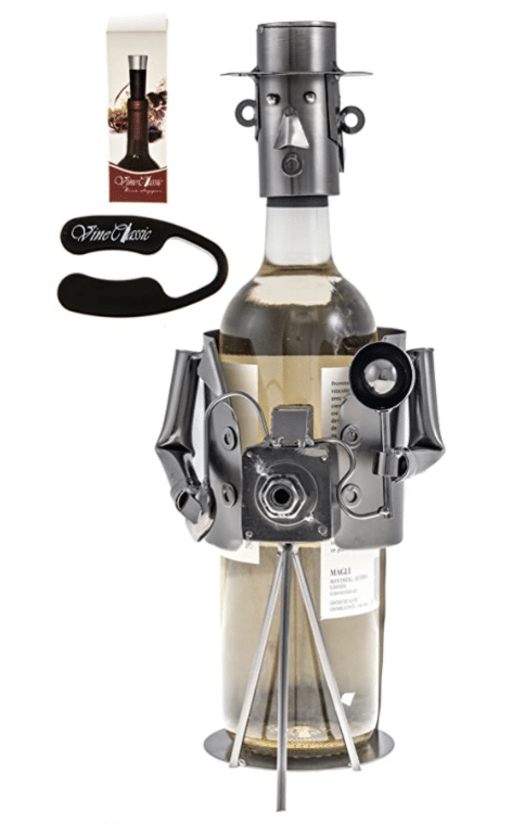 A metal wine bottle holder holding a camera and a flash.