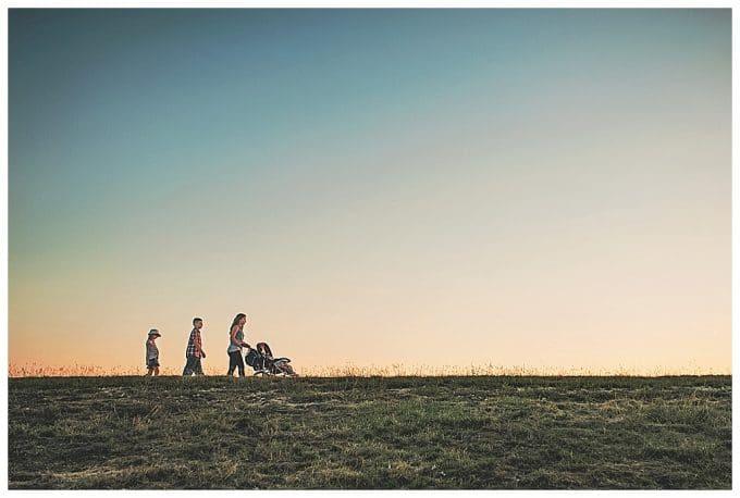 Photo of family at sunset walking across the horizon.