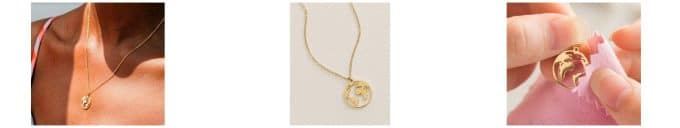 A small gold necklace with the outline of the world a great gift for photographers of anyone.